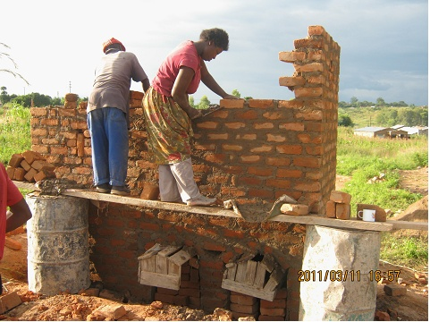 Women building low cost housing